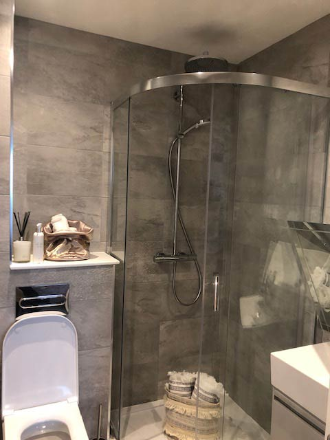 grey tiled shower cubicle